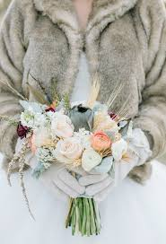 muted and pale mixed winter bouquet photo by sheffield