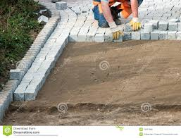 Laying Patio Slabs Laying Paving Bricks On Soil Royalty Free Stock Image Image