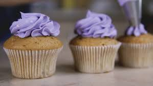 decorating cup cake with cream using cooking bag confectioner