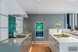 a contemporary kitchen design in weston mass behind the various cabinet fronts however is an intricately designed storage system that allows the family to make the most of every inch of their space