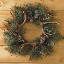 antler wreath would look better with a burlap bow wreaths