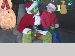 The Grinch Christmas Lights With Festive Holiday Lights Santee Man And The Grinch Give Santa