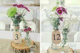 joyous rustic country wedding reception decorations table