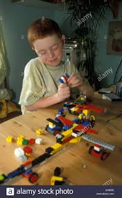 8 year old boy playing with lego uk stock photo royalty free