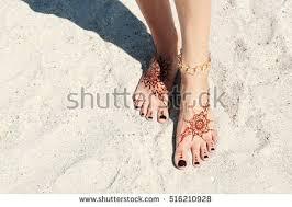 female legs henna tattoo on beach stock photo 516210865 shutterstock