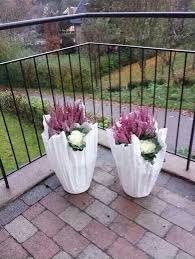 make a unique garden planter from an old towel cement planters