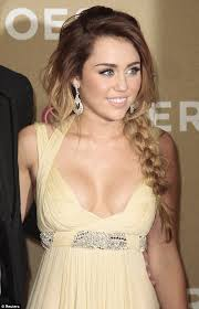 miley cyrus in low cut dress at cnn heroes awards ceremony daily