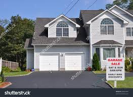 Two Car Garages by Garage Sale Sign On Black Top Stock Photo 88882405 Shutterstock
