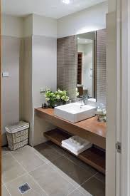 221 best home design bathrooms images on pinterest bathroom bathroom design idea wood benches coffee coloured tile feature wall complete tiling