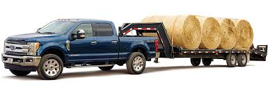 nissan titan jumps off bridge behind the wheel heavy duty pickup trucks consumer reports