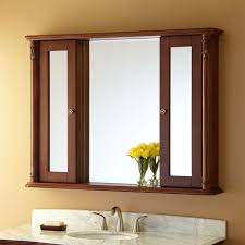 double brown wooden board shelf with bathroom mirror and double