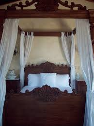wooden canopy bed with white curtains wooden canopy curtain
