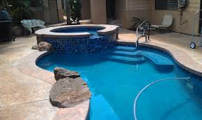 pacific blue hydrazzo huber pool stamped concrete coping and