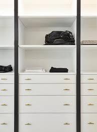white closet dresser with modern brass pulls contemporary closet