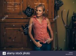 woman in country house look with braided hairstyle stock photo