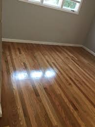 red oak floor refinished from a dark brown stain to natural