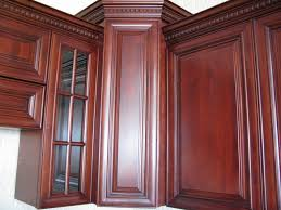 cherry wood corner cabinet kitchen cherry maple cabinets crown molding with dentil detail