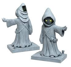 solar powered wars jawa lawn ornament with yellow glowing