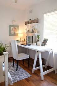 Home Office Table Chic Home Office Features A Wall Clad In Thibaut Ikat Wallpaper