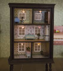 this dollhouse is made from a old dresser cute tiny lights
