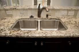granite countertop kitchen cabinet latch with mirror backsplash