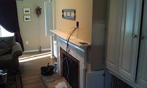 hanging tv above fireplace hide wires home design u0026 interior design