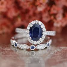 what is a bridal set ring blue sapphire engagement ring and bezel scalloped diamond wedding