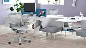 Grey Office Desks Gray Office Desk Two Light Gray Office Chairs In A Office