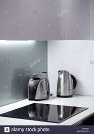 corner of modern designer kitchen with hob kettle and toaster