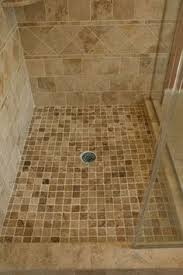 shower floor tiled with pebbles for the home