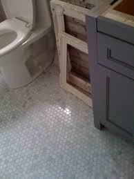 beautiful installation of carrara marble 1x1 hex tile platinum