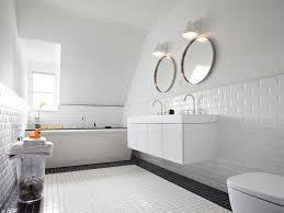 bathroom black and white tile round mirrors sloped ceiling double black and white tile round mirrors sloped ceiling double sinks storage vanity bathroom window wall sconces