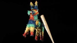 mexican pinata horse and candy breaking in slow motion after