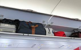 The Best Way To Put by How To Put Your Luggage In The Overhead Bin According To A Flight