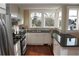 kitchen white cabinets black countertop heart of my home