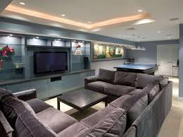 basement living room with grey wall color and sectional sofa