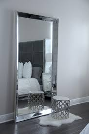 furniture silver leaner mirror plus stool and wooden floor for