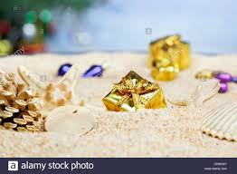 ornaments in the sand gold packages stock photo