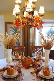 beautiful wheat centerpiece with pumpkin tureens decorating