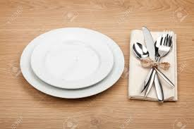 how to set a table with silverware empty plate and silverware set on wooden table stock photo picture