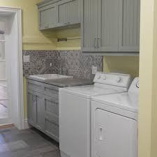 gray kitchen cabinets yellow walls 75 beautiful vinyl floor laundry room with yellow walls