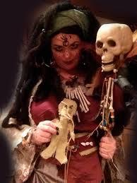 voodoo queen halloween costume holding skull spirit stick and
