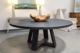 round reclaimed elm wood plank table with x leg