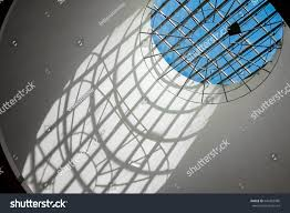 dark room light round window through stock photo 649382086