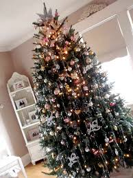 tree with tinsel tree holidays and