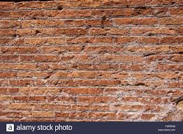 part of the old brick walls of the colosseum in rome stock photo