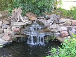 natural backyard waterfall decor with structure stone also small