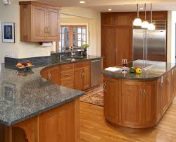 oval brown wooden kitchen island and curved brown wooden kitchen