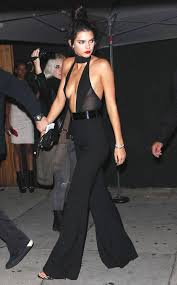 kendall jenner jumpsuit kendall jenner stuns in a plunging jumpsuit while celebrating
