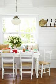 simple dining room design with white wooden dining table also